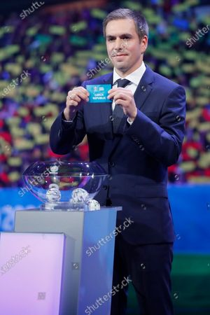 Draw assistant, Former German national soccer player Philipp Lahm shows the ticket of Czech Republic during the UEFA EURO 2020 final draw in Bucharest, Romania, 30 November 2019.