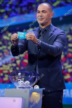 Draw assistant, Former Dutch football player Ruud Gullit shows the ticket of Croatia during the UEFA EURO 2020 final draw in Bucharest, Romania, 30 November 2019.