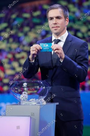 Draw assistant, Former German national soccer player Philipp Lahm shows the ticket of Sweden during the UEFA EURO 2020 final draw in Bucharest, Romania, 30 November 2019.