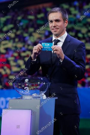Draw assistant, Former German national soccer player Philipp Lahm shows the ticket of Portugal during the UEFA EURO 2020 final draw in Bucharest, Romania, 30 November 2019.