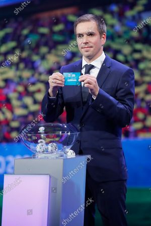 Draw assistant, Former German national soccer player Philipp Lahm shows the ticket of Denmark during the UEFA EURO 2020 final draw in Bucharest, Romania, 30 November 2019.