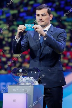 Draw assistant, FC Porto's goalkeeper Iker Casillas shows the ticket of Wales during the UEFA EURO 2020 final draw in Bucharest, Romania, 30 November 2019.