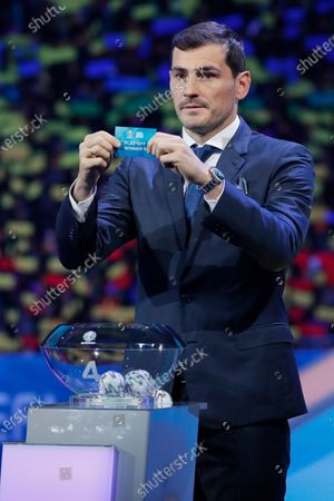Draw assistant, FC Porto's goalkeeper Iker Casillas shows the ticket of Playoff winner D during the UEFA EURO 2020 final draw in Bucharest, Romania, 30 November 2019.