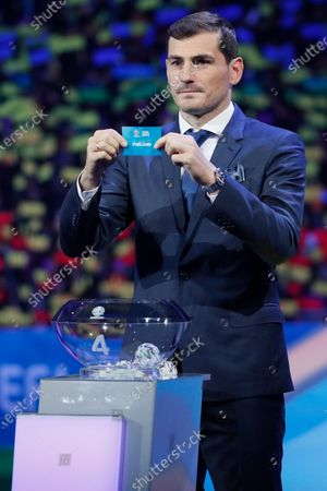 Draw assistant, FC Porto's goalkeeper Iker Casillas shows the ticket of Finland during the UEFA EURO 2020 final draw in Bucharest, Romania, 30 November 2019.