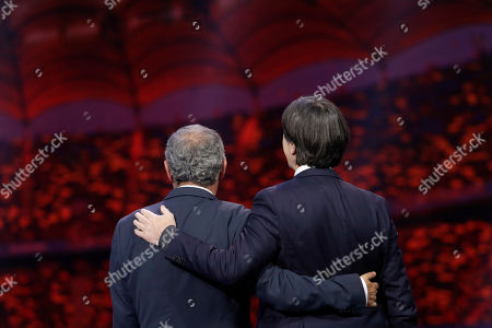 The coaches of Portugal Fernando Santos and Germany Joachim Loew, right, who will play in group F, talk to each other after the draw for the UEFA Euro 2020 soccer tournament finals in Bucharest, Romania