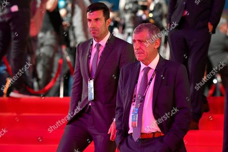 Portugal coach Fernando Santos, right, arrives with former Portugal player Luis Figo for the draw for the UEFA Euro 2020 soccer tournament finals in Bucharest, Romania