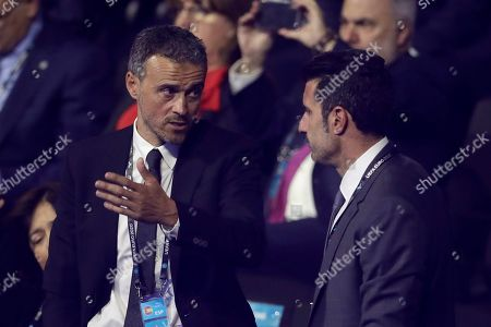 Stock Photo of Spain coach Luis Enrique, left, talks with Portugal former player Luis Figo before the draw for the UEFA Euro 2020 soccer tournament finals in Bucharest, Romania