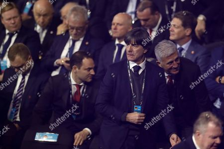 Germany coach Joachim Loew takes his seat to watch the draw for the UEFA Euro 2020 soccer tournament finals in Bucharest, Romania