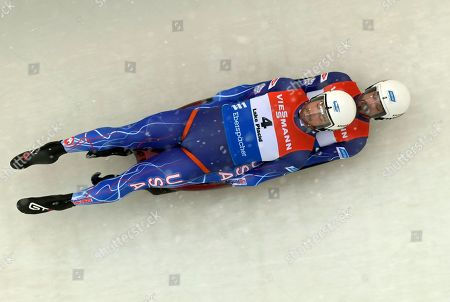 Chris Mazdzer and Jayson Terdiman, of the United States, take a turn during the first run of a doubles World Cup luge event in Lake Placid, N.Y., on