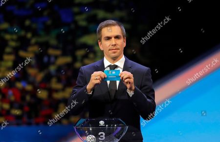 Germany's former soccer player Philipp Lahm holds up the name Sweden during the draw for the UEFA Euro 2020 soccer tournament finals in Bucharest, Romania
