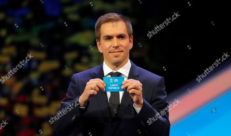 Stock Picture of Germany's former soccer player Philipp Lahm holds up the name Czech Republic during the draw for the UEFA Euro 2020 soccer tournament finals in Bucharest, Romania