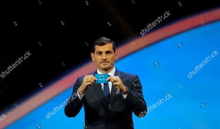 Spain's former goalkeeper Iker Casillas holds up the name Finland during the draw for the UEFA Euro 2020 soccer tournament finals in Bucharest, Romania