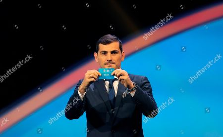 Spain's former goalkeeper Iker Casillas holds up the name Wales during the draw for the UEFA Euro 2020 soccer tournament finals in Bucharest, Romania