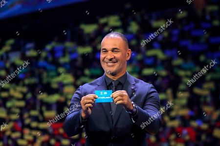 Netherland's former soccer player Ruud Gullit holds up the name Netherands during the draw for the UEFA Euro 2020 soccer tournament finals in Bucharest, Romania