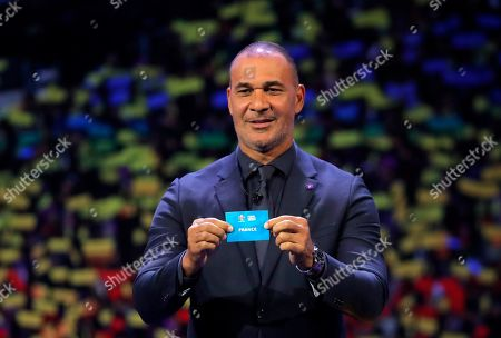 Netherland's former soccer player Ruud Gullit holds up the name France during the draw for the UEFA Euro 2020 soccer tournament finals in Bucharest, Romania