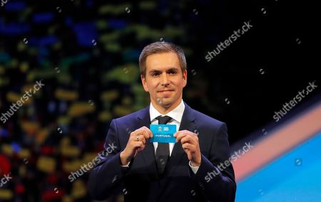 Germany's former soccer player Philipp Lahm holds up the name Portugal during the draw for the UEFA Euro 2020 soccer tournament finals in Bucharest, Romania