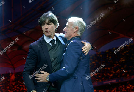 Stock Photo of Germany coach Joachim Loew, left, embraces France coach Didier Deschamps during the draw for the UEFA Euro 2020 soccer tournament finals in Bucharest, Romania