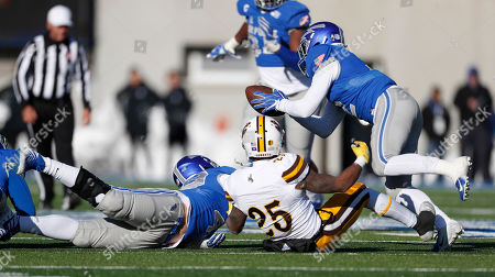 R m. Air Force defensive back Jeremy Fejedelem, right, intercepts a pass intended for Wyoming wide receiver Austin Conway, center, after the ball was tipped by Air Force linebacker Jake Ksiazek in the second half of an NCAA college football game, at Air Force Academy, Colo. Air Force won 20-6