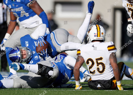R m. Air Force defensive back Jeremy Fejedelem, back, tumbles to the turf after intercepting a pass tipped by Air Force linebacker Jake Ksiazek, front left, that was intended for Wyoming wide receiver Austin Conway in the second half of an NCAA college football game, at Air Force Academy, Colo. Air Force won 20-6