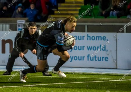 Glasgow Warriors vs Leinster. Glasgow's Ruaridh Jackson scores his second try of the game