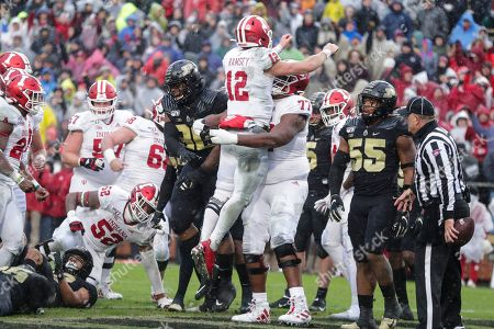 Peyton Ramsey, Caleb Jones. Indiana quarterback Peyton Ramsey (12) celebrates a touchdown against Purdue with offensive lineman Caleb Jones (77) during the first half of an NCAA college football game in West Lafayette, Ind