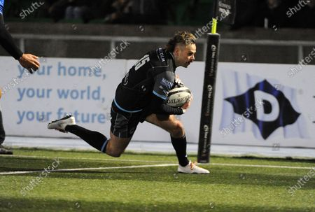 Ruaridh Jackson - Glasgow full back slides in for his second try in the first half.