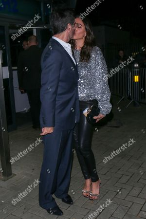 Stock Picture of Simon Cowell and Lauren Silverman