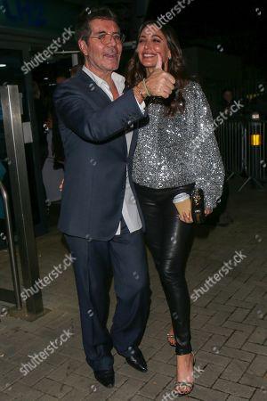 Stock Photo of Simon Cowell and Lauren Silverman