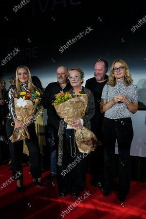 Carolina Crescentini (L), Italian film critic Emanuela Martini (C) and Festival Director Cristina Comencini (R) attend the awarding ceremony of the 37th Torino Film Festival, in Turin, Italy, 30 November 2019.