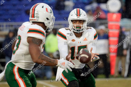 Miami quarterback Jarren Williams (15) pitches the ball to Cam'Ron Harris (23) during the second quarter of an NCAA college football game in Durham, N.C