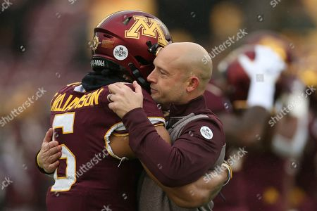 Minnesota head coach P.J. Fleck hugs defensive back Chris Williamson (6) during an NCAA college football game against Wisconsin, in Minneapolis. Wisconsin won 38-17