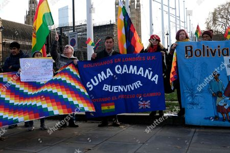 Protesters hold banners, Bolivian and Wiphala flags during the rally. People gathered outside Downing Street to raise their voices against the coup in Bolivia and show their support to ousted president Evo Morales.