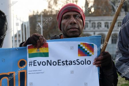 Stock Picture of Protesters hold banners, Bolivian and Wiphala flags during the rally. People gathered outside Downing Street to raise their voices against the coup in Bolivia and show their support to ousted president Evo Morales.