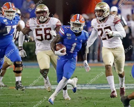 Kadarius Toney, Dennis Briggs Jr., Adonis Thomas. Florida wide receiver Kadarius Toney (1) runs past Florida State defensive end Dennis Briggs Jr. (58) and linebacker Adonis Thomas, right, for a long gain during the first half of an NCAA college football game, in Gainesville, Fla