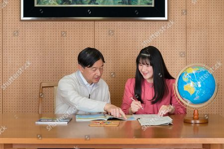 In this Nov. 25, 2019, photo provided by the Imperial Household Agency of Japan, Japan's Princess Aiko, right, talks with her father Emperor Naruhito at their residence in Tokyo. Princess Aiko celebrated her 18th birthday on