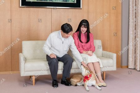 Aiko, Naruhito. In this Nov. 25, 2019, photo provided by the Imperial Household Agency of Japan, Japan's Princess Aiko, right, and her father Emperor Naruhito pose for a photo at their residence in Tokyo. Princess Aiko celebrated her 18th birthday on