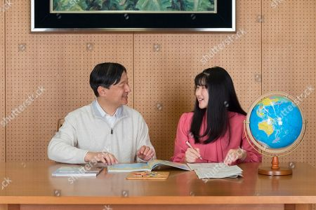 Stock Image of Aiko, Naruhito. In this Nov. 25, 2019, photo provided by the Imperial Household Agency of Japan, Japan's Princess Aiko, right, talks with her father Emperor Naruhito at their residence in Tokyo. Princess Aiko celebrated her 18th birthday on