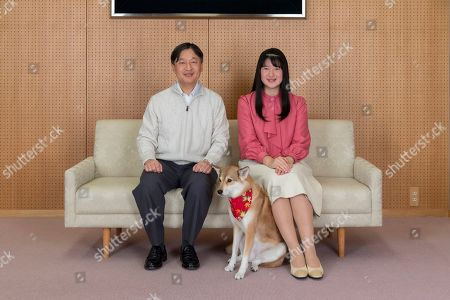 Stock Photo of Aiko, Naruhito. In this Nov. 25, 2019, photo provided by the Imperial Household Agency of Japan, Japan's Princess Aiko, right, and her father Emperor Naruhito pose for a photo at their residence in Tokyo. Princess Aiko celebrated her 18th birthday on