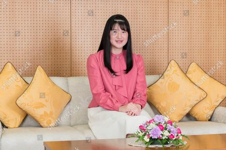 In this Nov. 25, 2019, photo provided by the Imperial Household Agency of Japan, Japan's Princess Aiko poses for a photo at her residence in Tokyo. Princess Aiko, daughter of Emperor Naruhito and Empress Masako, celebrated 18th birthday on