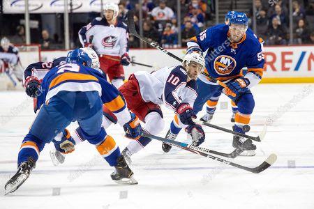 Johnny Boychuk, Nick Leddy, Alexander Wennberg. Columbus Blue Jackets center Alexander Wennberg (10) skates against New York Islanders defenseman Johnny Boychuk (55) and defenseman Nick Leddy (2) during the first period of an NHL hockey game, in New York
