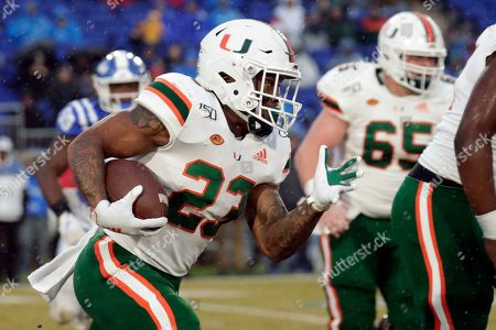 Miami's Cam'Ron Harris (23) runs the ball during the first half of an NCAA college football game between Miami and Duke in Durham, N.C