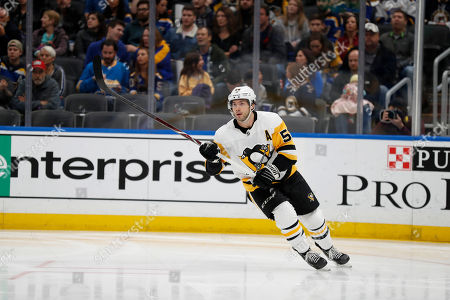 Pittsburgh Penguins' Kris Letang in action during the second period of an NHL hockey game against the St. Louis Blues, in St. Louis