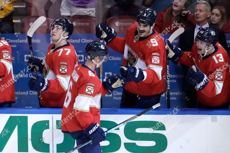 Florida Panthers defenseman Anton Stralman (6) is congratulated by center Brian Boyle (9) and defenseman Mark Pysyk (13) after scoring a goal during the third period of an NHL hockey game against the Nashville Predators, in Sunrise, Fla. The Panthers won 3-0