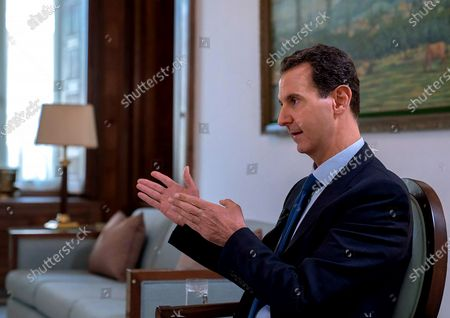 Stock Photo of Syrian President Bashar al-Assad gesturing during an interview given to French Paris Match Magazine