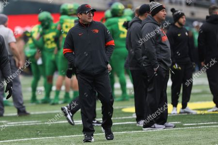 Oregon State head coach Jonathan Smith looks on during warm ups prior to the start of an NCAA college football game against Oregon in Eugene, Ore., . Oregon won 24-10
