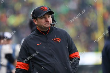 Oregon State head coach Jonathan Smith looks at the scoreboard during the first half of an NCAA college football game against Oregon in Eugene, Ore., . Oregon won 24-10