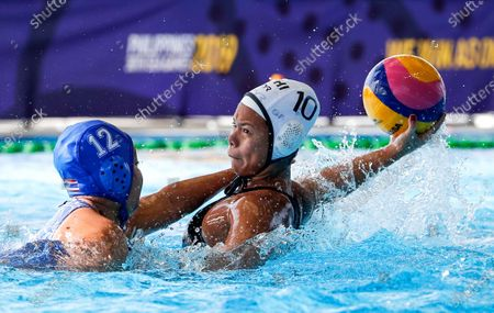 Grabador Carla Beatriz (R) of the Philippines in action against Turon Issaree (L) of Thailand during SEA Games 2019 Water Polo Women's Double Round Robin match at the New Clark City Aquatics Center in Tarlac province, north of Manila, Philippines, 01 December 2019..
