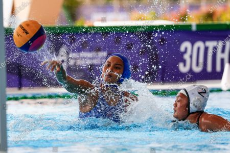 Stock Photo of Saraikarn Varisitha (L) of Thailand in action against Sicat Gabriella (R) of the Philippines during SEA Games 2019 Water Polo Women's Double Round Robin match at the New Clark City Aquatics Center in Tarlac province, north of Manila, Philippines, 01 December 2019.