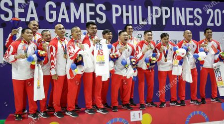 Players of Singapore react at the award ceremony after winning the gold in the SEA Games 2019 men's Water Polo round robin match at the New Clark City Aquatics Center near Capas, Philippines, 01 December 2019 (issued 02 December 2019).