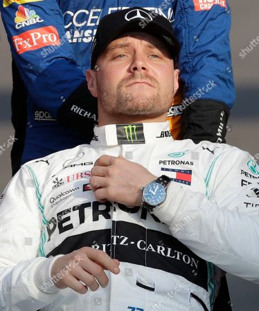 Mercedes driver Valtteri Bottas of Finland gestures during the end season driver's picture at the Emirates Formula One Grand Prix, at the Yas Marina racetrack in Abu Dhabi, United Arab Emirates, Sunday, Dec.1, 2019